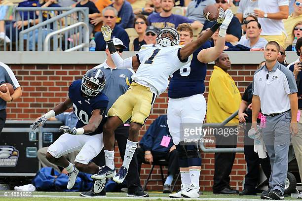 Qua Searcy of the Georgia Tech Yellow Jackets makes a one handed catch out of bounds against Kindle Vildor of the Georgia Southern Eagles during the...
