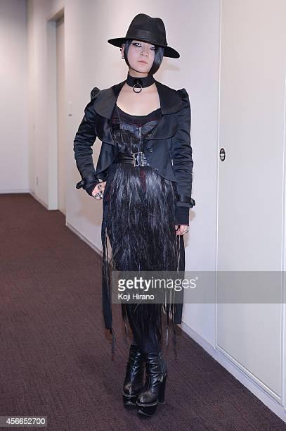 Qua wears all Alice Auaa at MercedesBenz Fashion Week Tokyo Autumn/Winter 2014 at Shibuya Hikarie on March 22 2014 in Tokyo Japan