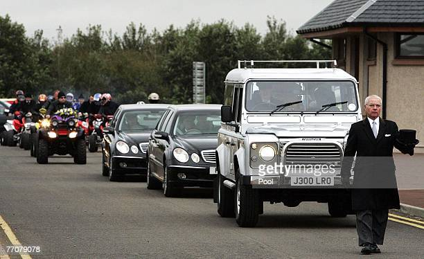 Quad bikers follow the Land Rover hearse carrying the coffin of former quad bike champion Graeme Duncan to his funeral on September 28 2007 in...