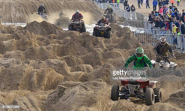Quad bikes and sidecar competitors in the Hydrogarden Western Beach Race on October 8 2016 in WestonSuperMare England