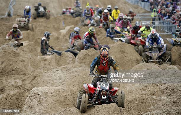 A quad rider negogiates the bumps during the Adult Quad and Sidecar race duringthe 2016 HydroGarden Weston Beach Race in WestonsuperMare south west...