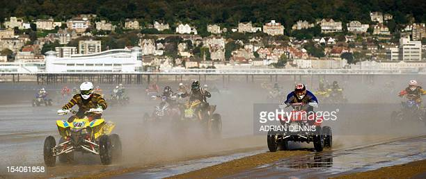 Quadbike riders race down the beach during the main quad and sidecar race during the 2012 RHL Weston beach race in WestonSuperMare southwest England...