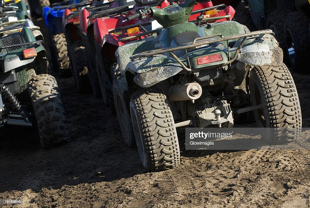 Quadbikes parked in a row : Stock Photo