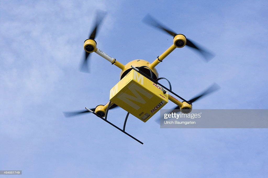 A Quadcopter Drone Arrives With Small Delivery Starts Its Journey Over The River Rhine To