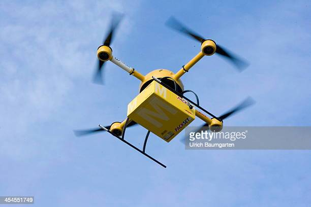 A quadcopter drone arrives with a small delivery starts it's journey over the river Rhine to the Deutsche Post/DHL headquarters on December 9 2013...