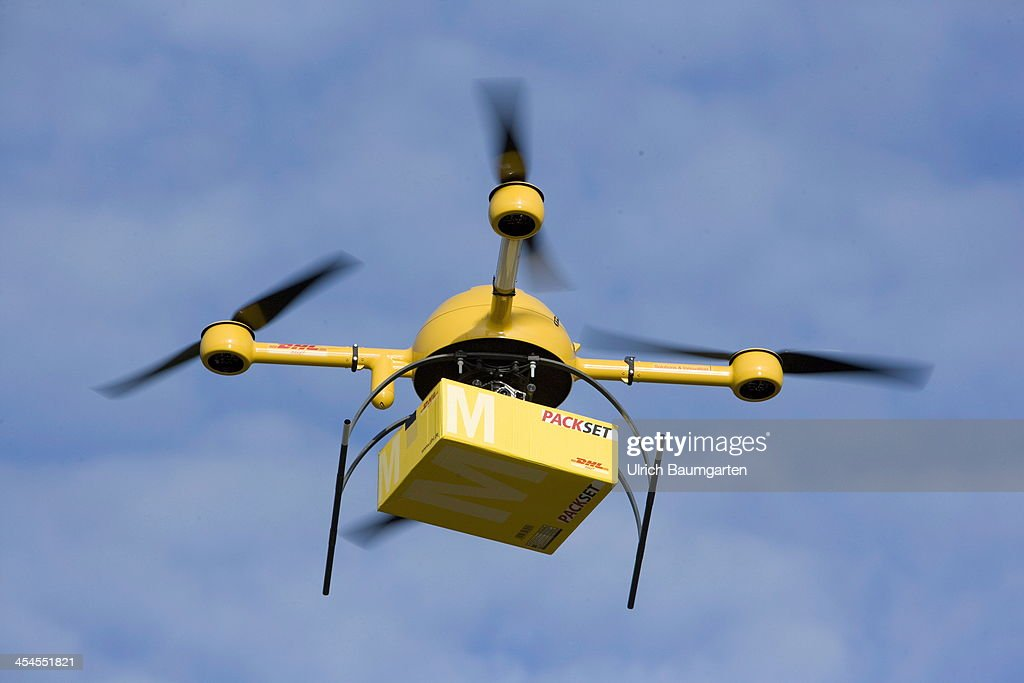 A Quadcopter Drone With Small Delivery Starts Its Journey Over The River Rhine To