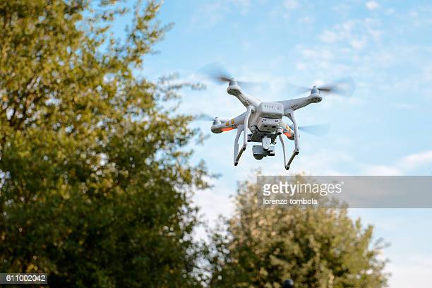 Quadcopter Drone With Camera Flying Among the Trees