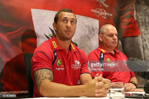 Quade Cooper and Coach Ewen Mckenzie speak to media during a press conference to announce he is staying with the Queensland Reds at Ballymore Stadium...