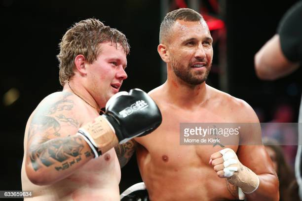 Quade Cooper and Jack McInnes look on after their heavyweight bout at Adelaide Oval on February 3 2017 in Adelaide Australia