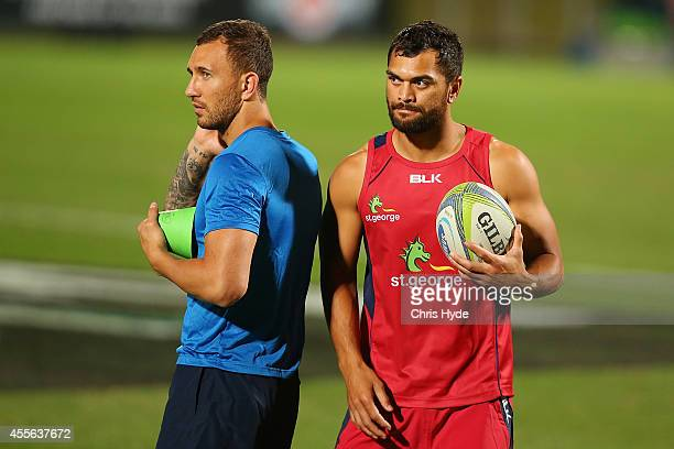 Quade Cooper and Karmichael Hunt talk during a Queensland Reds training session at Ballymore Stadium on September 18 2014 in Brisbane Australia