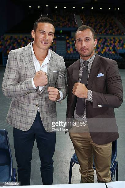 Quade Cooper and Sonny Bill Williams pose for a photograph during a press conference at Brisbane Entertainment Centre on November 26, 2012 in...