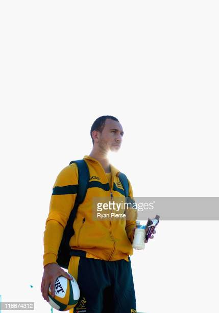 Quade Cooper arrives at training during an Australian Wallabies training session at Coogee Oval on July 12 2011 in Sydney Australia