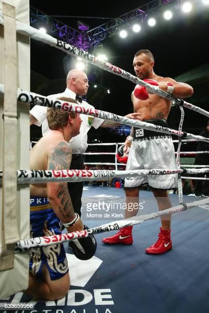 Quade Cooper looks on as the referee stops his heavyweight bout with Jack McInnes at Adelaide Oval on February 3 2017 in Adelaide Australia