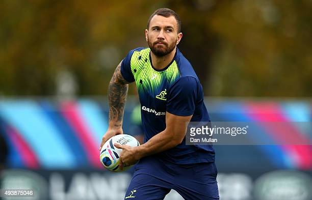 Quade Cooper of Australia passes the ball during a training session at The Lensbury Hotel on October 23 2015 in London United Kingdom