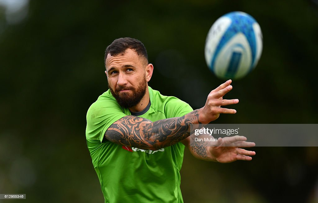 Quade Cooper of Australia releases a pass during an Australia training session at The Lensbury Hotel on October 6, 2016 in London, United Kingdom.