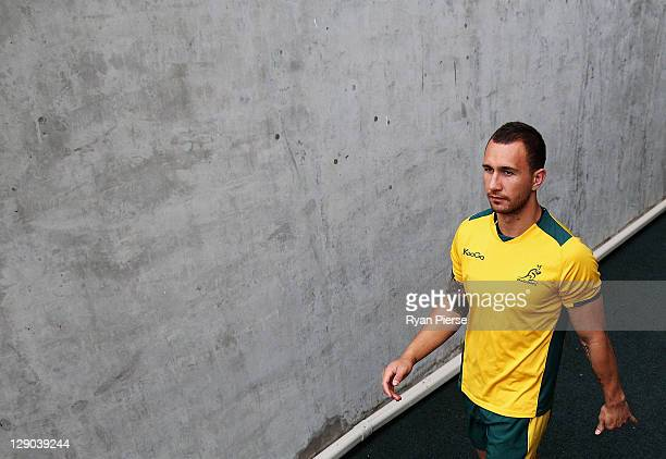 Quade Cooper of Australia walks onto the pitch during an Australia IRB Rugby World Cup 2011 training session at North Harbour Stadium on October 12...