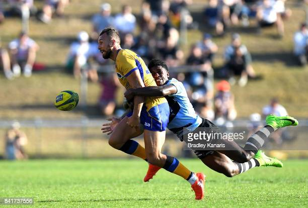 Quade Cooper of Brisbane City gets the pass away as he is pressured by the defence during the round one NRC match between Brisbane and Fiji at...