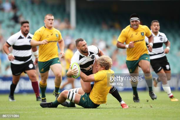 Quade Cooper of the Barbarians is tackled by Ned Hanigan of the Wallabies during the match between the Australian Wallabies and the Barbarians at...