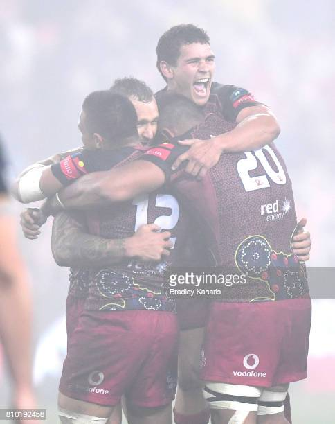 Quade Cooper of the Reds and team mates celebrate victory after the round 16 Super Rugby match between the Reds and the Brumbies at Suncorp Stadium...