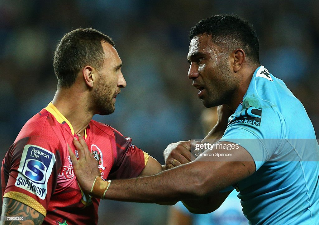 Quade Cooper of the Reds and Wycliff Palu of the Waratahs exchange words during the round 18 Super Rugby match between the Waratahs and the Reds at Allianz Stadium on June 13, 2015 in Sydney, Australia.