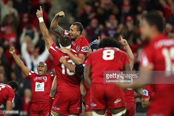 Quade Cooper of the Reds celebrates with winning the 2011 Super Rugby Grand Final match with team mates between the Reds and the Crusaders at Suncorp...