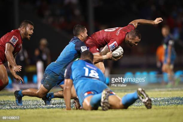 Quade Cooper of the Reds is tackled during the round 15 Super Rugby match between the Blues and the Reds at Apia Park National Stadium on June 2 2017...