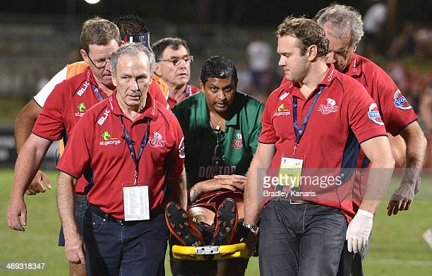 Quade Cooper of the Reds is taken from the field on a stretcher and in a neck brace during the Super Rugby trial match between the Queensland Reds...