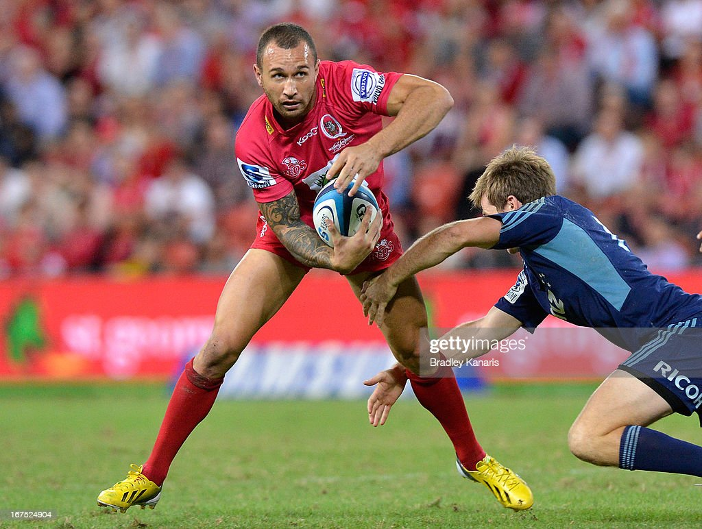 Quade Cooper of the Reds looks to take on the defence during the round 11 Super Rugby match between the Reds and the Blues at Suncorp Stadium on April 26, 2013 in Brisbane, Australia.