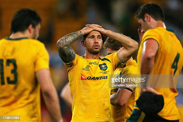 Quade Cooper of the Wallabies and team mates look dejected after losing The Rugby Championship match between the Australian Wallabies and the South...