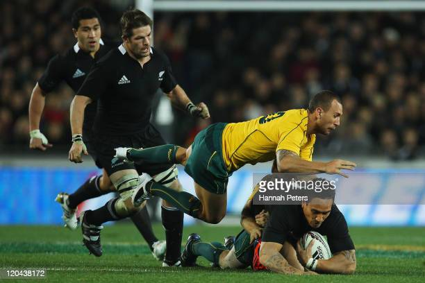 Quade Cooper of the Wallabies dives over the top of Hosea Gear of the All Blacks during the Tri-Nations Bledisloe Cup match between the New Zealand...