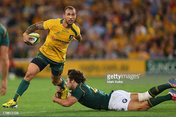 Quade Cooper of the Wallabies evades a tackle during The Rugby Championship match between the Australian Wallabies and the South African Springboks...