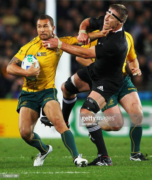 Quade Cooper of the Wallabies is tackled by Brad Thorn of the All Blacks during semi final two of the 2011 IRB Rugby World Cup between New Zealand...