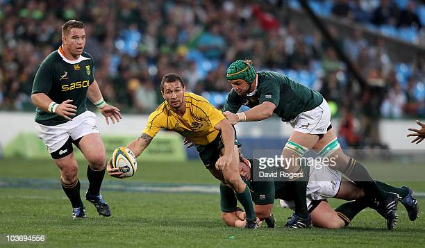 Quade Cooper of the Wallabies off loads the ball during the 2010 TriNations match between the South African Springboks and the Australian Wallabies...