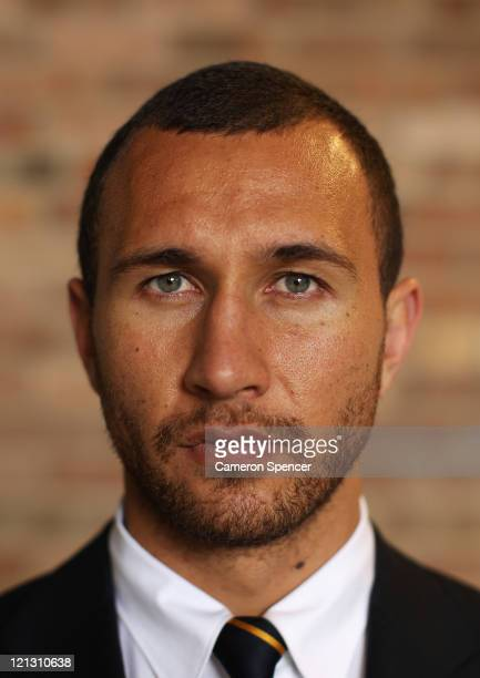 Quade Cooper of the Wallabies poses during an Australian Wallabies 2011 Rugby World Cup Squad portrait session at Sydney International Airport on...