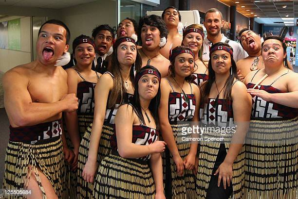 Quade Cooper of the Wallabies poses with performers as the Australian Wallabies IRB Rugby World Cup 2011 team arrive at Wellington Airport on...