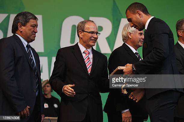 Quade Cooper of the Wallabies receives his Rugby World Cup cap from Mayor of Auckland Len Brown and Kaumatua Matt Maihi during the Australian...
