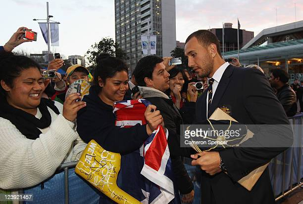 Quade Cooper of the Wallabies signs autographs during the Australian Wallabies IRB Rugby World Cup 2011 official team welcome ceremony at Aotea...