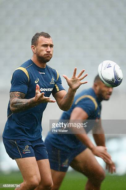 Quade Cooper of the Wallabies takes a pass during the Australian Wallabies Captain's Run at Eden Park on August 14 2015 in Auckland New Zealand