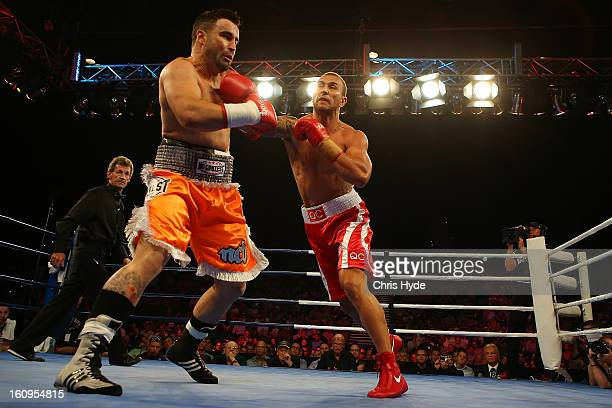Quade Cooper punches Barry Dunnett in their cruiserweight fight at the Brisbane Entertainment Centre on February 8 2013 in Brisbane Australia
