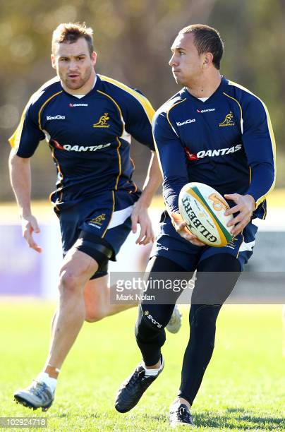 Quade Cooper runs the ball as Matt Giteau supports during a Wallabies training session at St Marys League stadium on July 16 2010 in Penrith Australia