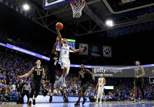 Quade Green of the Kentucky Wildcats makes a game winning layup with five seconds remaining against the Vanderbilt Commodores in overtime at Rupp...
