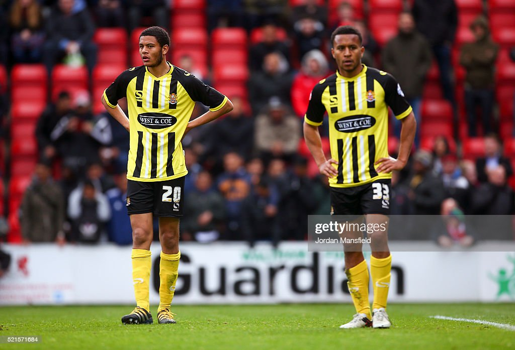 Quade Taylor and Joe Widdowson of Dagenham & Redbridge look dejected after their 3-2 loss during the Sky Bet League Two match between Leyton Orient and Dagenham & Redbridge at Brisbane Road on April 16, 2016 in London, England.
