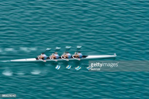 quadruple scull rowing team practicing, blurred motion - velocità foto e immagini stock