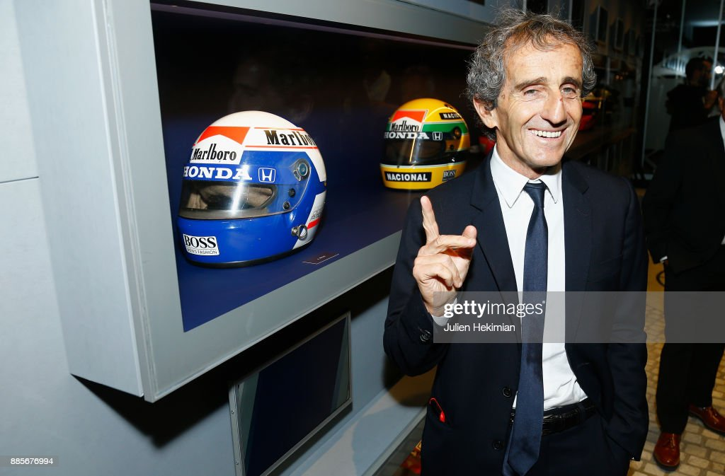 Quadruple World Champion Formula 1 Driver Alain Prost his pictured with his helmet during the FIA Hall of Fame Induction ceremony at Automobile Club De France on December 4, 2017 in Paris, France.