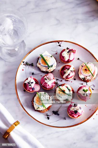 quails egg and goats cheese canapòs on plate, overhead view - savory food stock pictures, royalty-free photos & images
