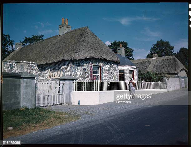 Quaint and colorful house on a country road near Kildare Ireland decorated in brilliant designs and made by hand from cement seashells and bits of...