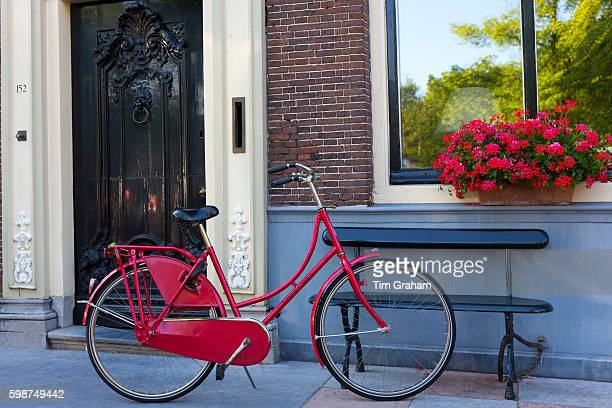 Quaint canalside house facade 16th century with traditional bicycle in Edam The Netherlands