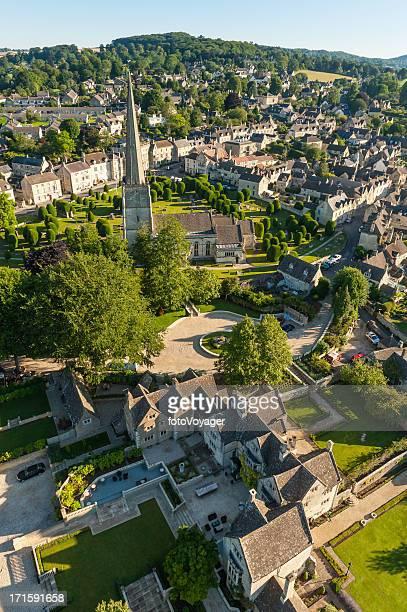 quaint cotswold village homes church spire gloucestershire uk - overhemd en stropdas stock pictures, royalty-free photos & images