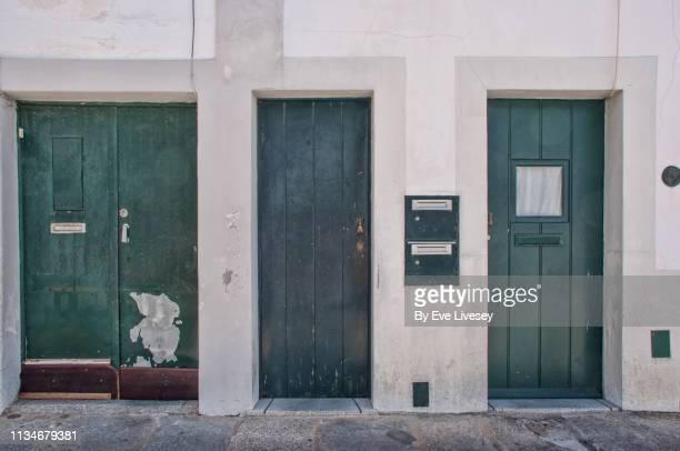 quaint medieval doors in évora - hand of fatima stock photos and pictures