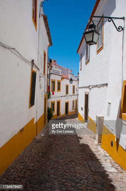 quaint medieval street in évora - southern europe stock pictures, royalty-free photos & images